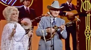 Bill Monroe & Dolly Parton Team Up For Toe-Tapping Bluegrass Duet