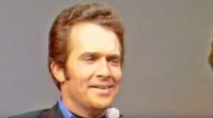 Young & Flirty Merle Haggard Sings His Rebellious Hit, 'Fightin' Side Of Me'