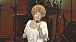 """Brenda Lee Dons White Gown For """"Rockin' Around The Christmas Tree"""" In 1984"""