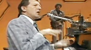 """""""Me & Bobby McGee"""" Gets Flaming Piano Treatment At Hands Of Jerry Lee Lewis"""