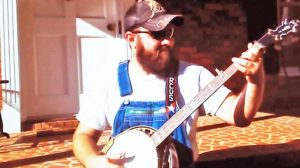 Southern Man Picks Banjo To The Tune Of 'Will The Circle Be Unbroken'
