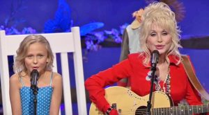 Dolly Parton & Little Girl Who Played Her In 'Coat Of Many Colors' Team Up For Moving Duet