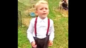 Cute Suspender-Wearing Cowboy Proudly Sings Kenny Rogers' 'The Gambler'