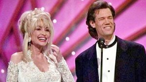 Dolly Parton Sneaks Up On Randy Travis, And His Reaction Is Priceless