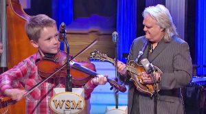 10-Year-Old Joins Ricky Skaggs For 'Blue Moon Of Kentucky' Duet At The Opry