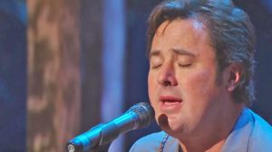 Vince Gill's Tear-Jerking Performance Of 'Go Rest High On That Mountain' Will Break Your Heart