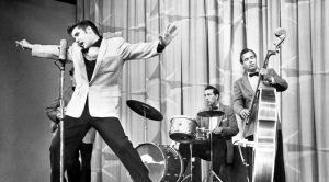 "Elvis Presley's Controversial First TV Performance Shocked America With ""Shake, Rattle, & Roll"""
