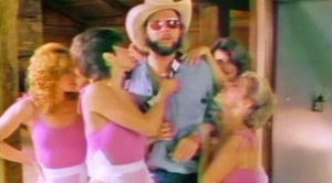 Hank Williams Jr. Invites Country Music Legends To Epic Party In 'All My Rowdy Friends' Video