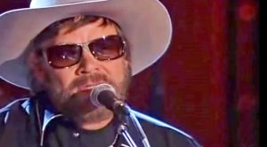 Merle's 'Are The Good Times Really Over' Earns Tip Of The Hat From Hank Jr. In Haunting Performance