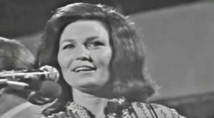 "Loretta Lynn Shines Bright In Rare Concert Footage Performing ""You Ain't Woman Enough"""