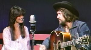 Waylon Jennings & Jessi Colter Engage In Flirty Banter After He Sings Silly Song For Her