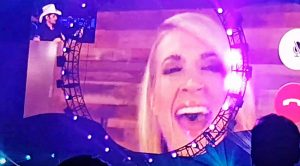 "Brad Paisley Facetimes Carrie Underwood At Concert For ""Remind Me"" Duet"