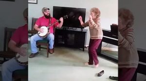 85-Year-Old Kicks Off Loafers & Breaks Into Epic Bluegrass Shuffle