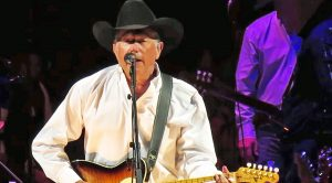 Merle Haggard's Legacy Lives On In George Strait's Sincere Cover Of 'Sing Me Back Home'