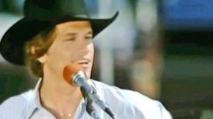 Footage Resurfaces Of Young George Strait Singing Debut Single 'Unwound' On A Boat
