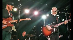 "Kris Kristofferson & Merle's Son Share Pleading ""Why Me Lord?"" With Captivated Crowd"