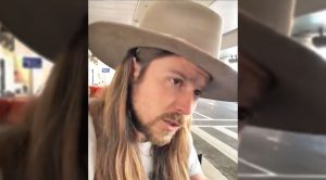 """Lukas Nelson Performs Dad Willie's Song, """"Bloody Mary Morning,"""" For Airport Goers"""