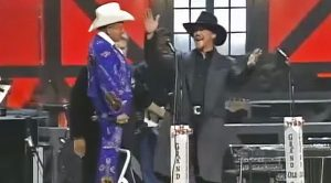 Little Jimmy Dickens Interrupts Trace's Performance To Ask Him A Life-Changing Question