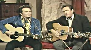 "You Aren't A True Fan Until You've Seen Cash And Haggard's ""Sing Me Back Home"""