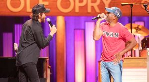 Darius Rucker & Chris Janson Take The Opry Old School With Rowdy Hank Jr. Cover