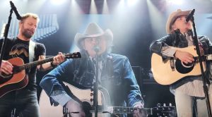 "Dwight Yoakam Crashes Dierks Bentley's Stage To Sing ""A Thousand Miles From Nowhere"" & ""Fast As You"""