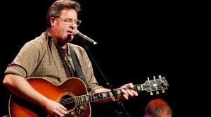 "Vince Gill Sings New Verse He Wrote For ""Go Rest High On That Mountain"""