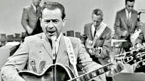 Jimmy Dickens Bounces Through Side-Splitting Song 'May The Bird Of Paradise Fly Up Your Nose'