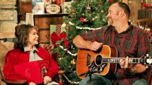 "Loretta Lynn Enlists John Carter Cash To Play Guitar While She Sings ""Country Christmas"""