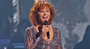 Reba Channels Dolly's Holiday Spirit With 'Hard Candy Christmas'