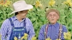 """Young Garth Brooks Can't Stop Laughing During """"Hee Haw"""" Sketch"""