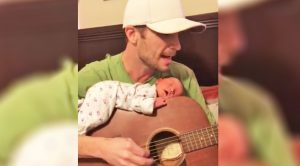 "Dad Sings Tom Petty's ""Alright For Now"" While Newborn Sleeps On Guitar"