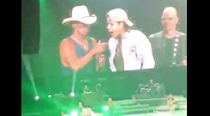 "Kenny Chesney Brings Injured Fan On Stage in 2019, She Sings ""She Thinks My Tractor's Sexy"""
