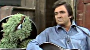 "Johnny Cash Visits Oscar The Grouch On Sesame Street, Sings ""Nasty Dan"""
