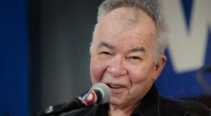 "John Prine's Wife Shares Update – He ""Needs Our Prayers And Love"""