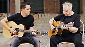 """John Prine's Son Performs Tribute to His Late Dad With """"Clocks & Spoons"""""""