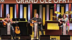 "Vince Gill, Amy Grant & Daughters Take The Opry Stage To Sing ""You Are My Sunshine"""