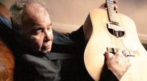"John Prine's Last Recorded Song, ""I Remember Everything,"" Becomes His First #1 Billboard Hit"