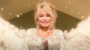 "Dolly Parton Is An Angel In Netflix Trailer For ""Christmas In The Square"""