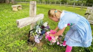 Indy Feek Lays Flowers On Joey's Grave On Mother's Day